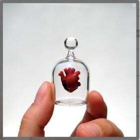 Blown Glass heart in a jar $400